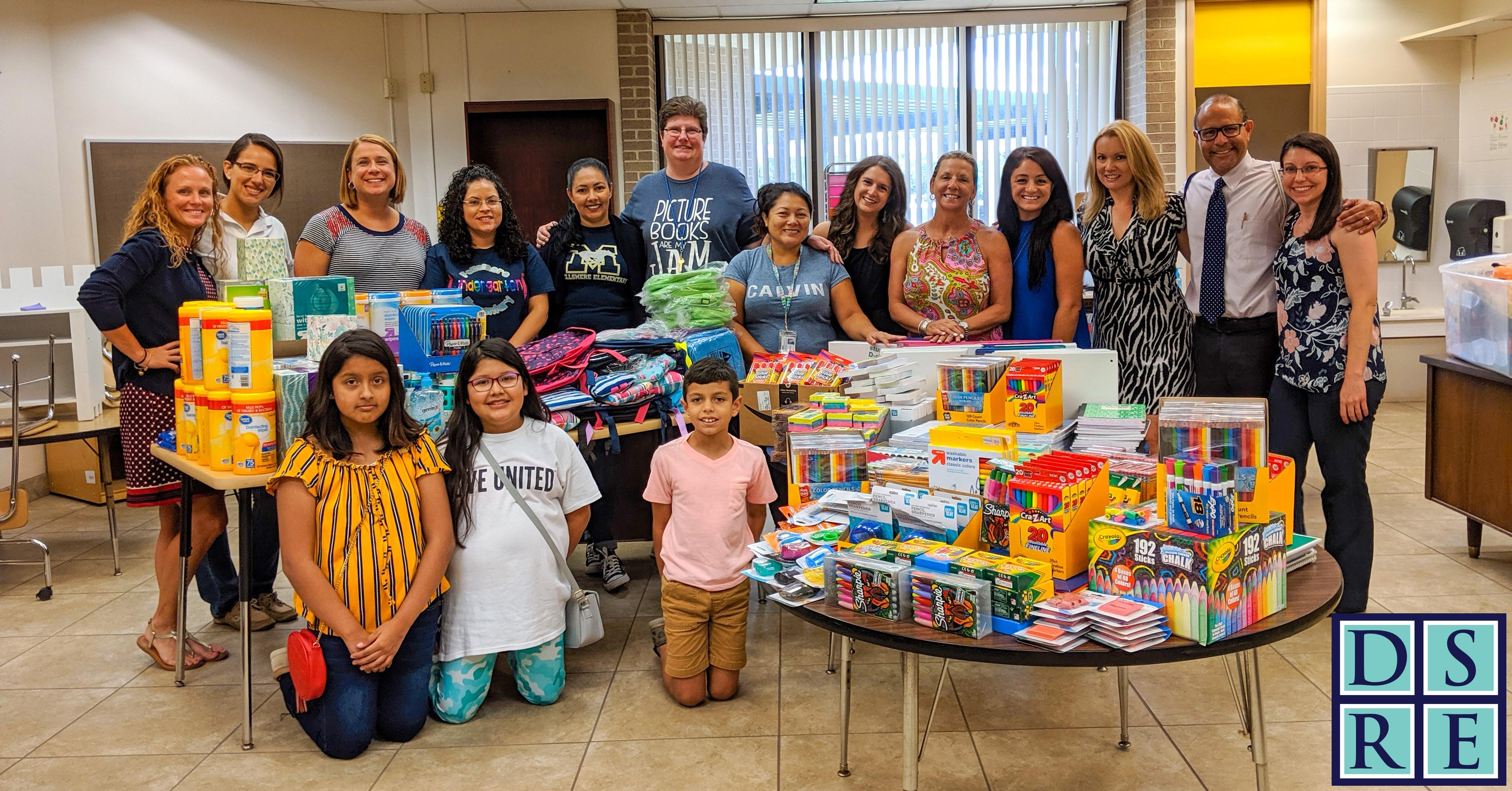 Dale Sorensen Real Estate staff and agents conduct back to school drive