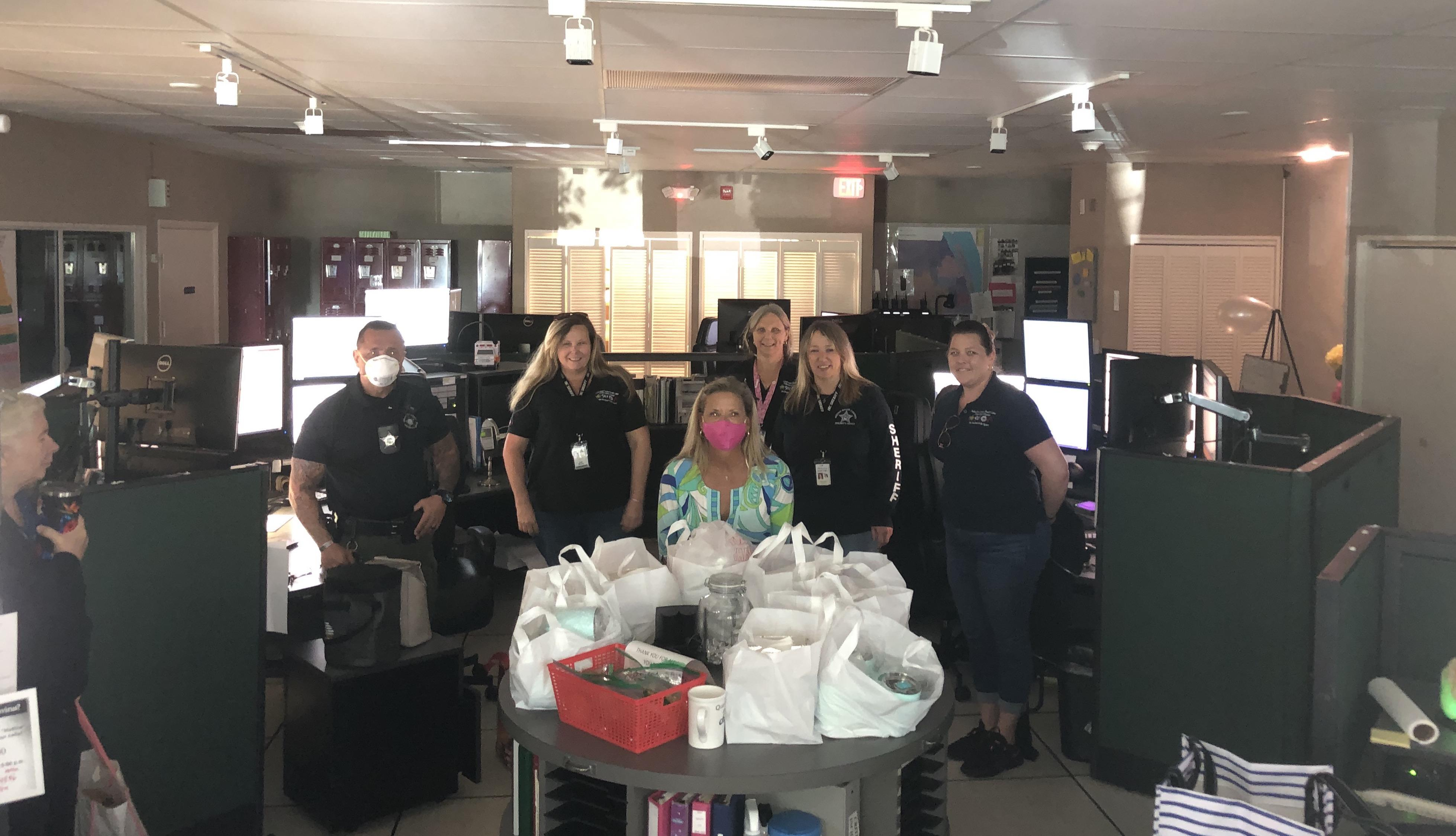 Dale Sorensen Real Estate sales agent Lori Davis donates lunches to Indian River County 911 Dispatchers